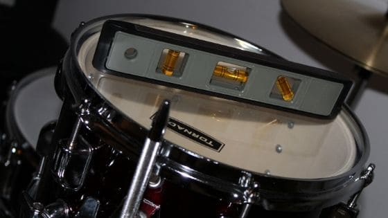best acoustic drum kit for home recording - adjusting toms using bubble level