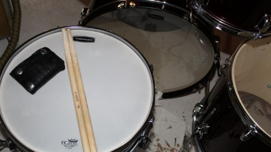 best acoustic drum kit for home recording - dampen snare using wallet